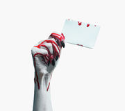Vampire bloody hand with empty card Royalty Free Stock Images