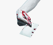 Vampire bloody hand gives empty card Stock Photos