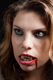 Vampire with the bloody teeth Royalty Free Stock Photos