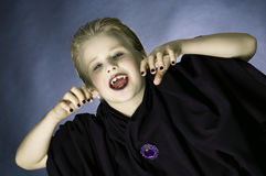 Vampire boy. Boy dressed up as a vampire for Halloween party Stock Photography
