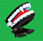 Vampire Chattering Teeth. A bold illustration of a fanged novelty toy Stock Images