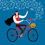 Vampire on city bicycle with pumpkin Stock Photography
