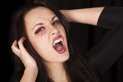 Vampire close fangs hands up Royalty Free Stock Photos