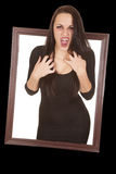 Vampire come out window hands chest. A woman vampire coming through picture frame with her mouth open Stock Photography