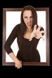 Vampire come out window reach. A woman vampire reaching out through a frame Royalty Free Stock Images