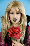 Vampire Costume. A little girl dressed up as a vampire maiden for Halloween showing her vampire fangs royalty free stock photos