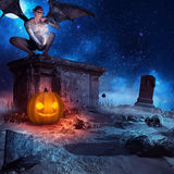 Vampire crouching on the stone tomb Stock Image