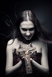 Vampire with crucifix Stock Photos
