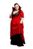 Vampire d'isolement dans la robe rouge de dessus-collet Photographie stock