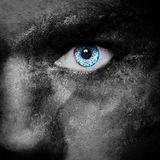 Vampire face. Vampire blue eye - dark portrait Royalty Free Stock Photos
