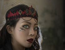 Vampire fashion woman with green pupil eyes. Asian Vampire woman green pupil eyes Stock Photography