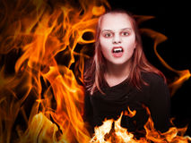 Vampire on fire. Female vampire burning in the fire, composing royalty free stock image