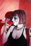 Vampire girl with glass of red blood drink Royalty Free Stock Photo