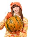 Vampire girl holding pumpkin Stock Image