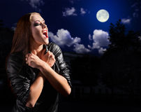 Vampire girl on night sky Stock Photography