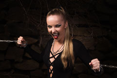 Vampire girl in a silver chains Royalty Free Stock Images