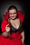 Vampire with glass full of blood Stock Photo