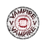 Vampire grunge rubber stamp. Red grunge rubber stamp with vampire teeth and the word vampire written with bloody letters royalty free illustration