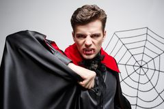 Vampire Halloween Concept - Portrait of Angry caucasian vampire screaming. Vampire Halloween Concept - Portrait of Angry caucasian vampire screaming Stock Images