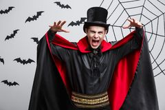 Vampire Halloween Concept - Portrait of Angry caucasian vampire screaming. Vampire Halloween Concept - Portrait of Angry caucasian vampire screaming Royalty Free Stock Photo