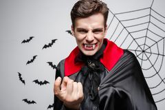 Vampire Halloween Concept - Portrait of Angry caucasian vampire screaming. Vampire Halloween Concept - Portrait of Angry caucasian vampire screaming Stock Photos