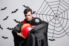 Portrait of handsome caucasian in Vampire halloween costume with colorful Balloon. Vampire Halloween Concept - Portrait of handsome caucasian in Vampire Royalty Free Stock Photos