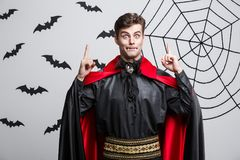 Vampire Halloween Concept - Portrait of handsome caucasian in Vampire halloween costume poining on side. Vampire Halloween Concept - Portrait of handsome Stock Image