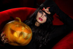 Vampire with halloween pumpkins Royalty Free Stock Image