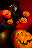 Vampire with halloween pumpkins Stock Photo