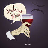 Vampire hand. Holding a glass of wine Royalty Free Stock Images