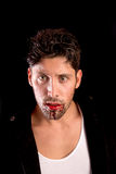 Vampire. Handsome vampire isolated in dark background Stock Photography