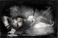 Vampire Heart. Beautiful and young vampire girl lying on a couch Stock Photo