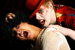 Vampire and his victim. royalty free stock image