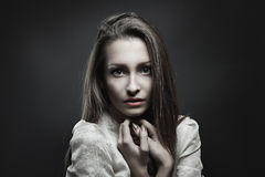 Vampire with innocent eyes Royalty Free Stock Photos