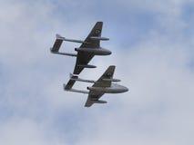 Vampire jet pair. Yeovilton, UK - 11th July 2015: Vintage Vampire jet pair flying at Yeovilton Air Day Stock Photo