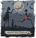Vampire in the night. A scared woman terrified on a Halloween night party with Vampire Royalty Free Stock Images