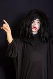 Vampire pointing forefinger Royalty Free Stock Photo