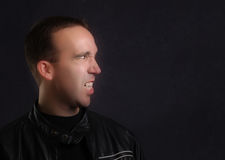 Vampire Portrait. Profile view of a modern vampire wearing a leather jacket Royalty Free Stock Photos