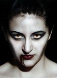 Vampire. Portrait of a female vampire. Halloween theme. Demon woman, closeup face Stock Photography