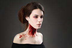 Vampire. Portrait of a female vampire over black background Stock Image