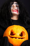Vampire with pumpkin Royalty Free Stock Images