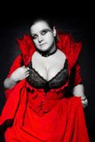 Vampire in red dress looking up Stock Photography