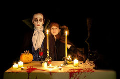 Vampire's halloween. The evening meal on Halloween. Pumpkin, blood and black cat Royalty Free Stock Photo