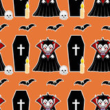 Vampire seamless pattern 4. Vampire man cartoon character in a predatory pose with coffin, flying bats, candle and skull Royalty Free Stock Images