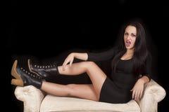 Vampire Sit Legs Up On White Bench Stock Photo