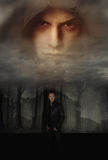 A vampire story. Two enemy vampire in a dark and cloudy forest royalty free stock images