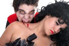 Vampire whith brunette girl. Vampire biting his women on white background Stock Photo