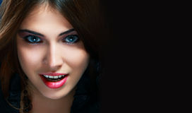 Vampire witch. Lady Vamp or Halloween witch Style. Brunette Woman close-up Portrait with copyspace Stock Photos