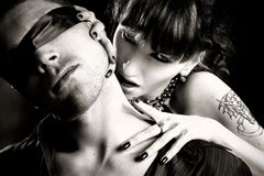 Vampire woman bites a blind man. Black and white photo of  vampire woman  bites a blind man Stock Photography