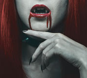 Vampire woman in the blood Royalty Free Stock Photos